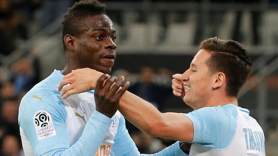 Marseille's Mario Balotelli celebrates scoring their first goal with Florian Thauvin.