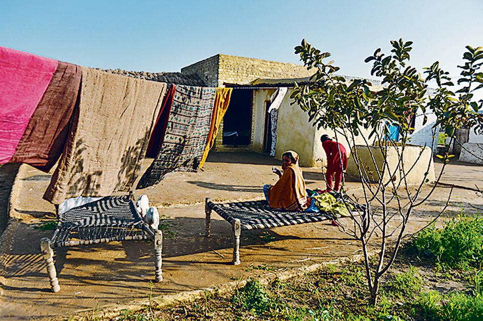 In the courtyard: A home near the India-Pakistan border.