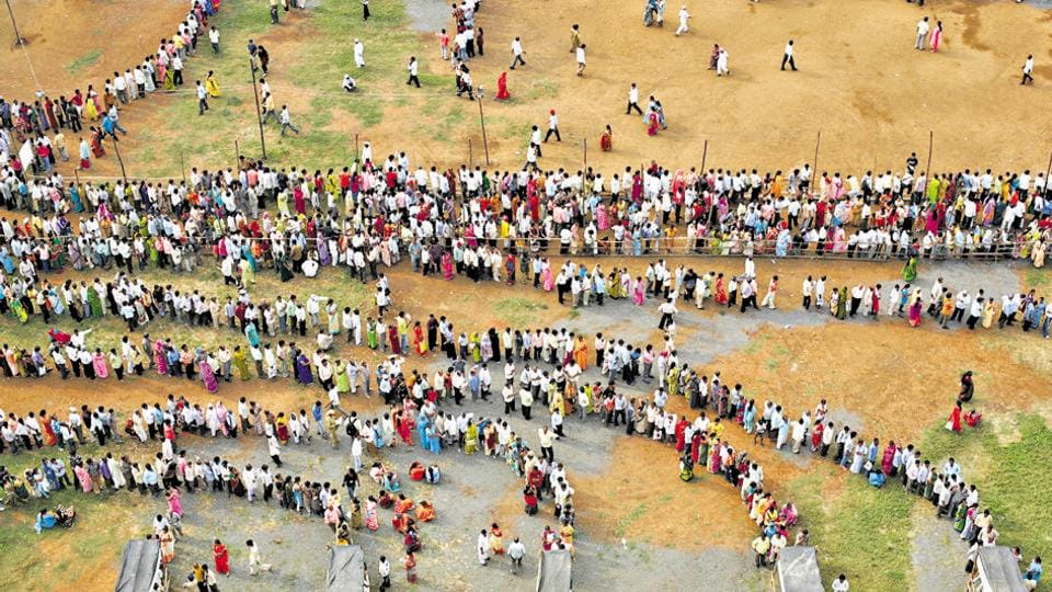 Mumbai, India - October 13, 2009: People queue to cast their votes outside a polling center during the Maharashtra state elections in Chandivali, Mumbai, on October 13, 2009.