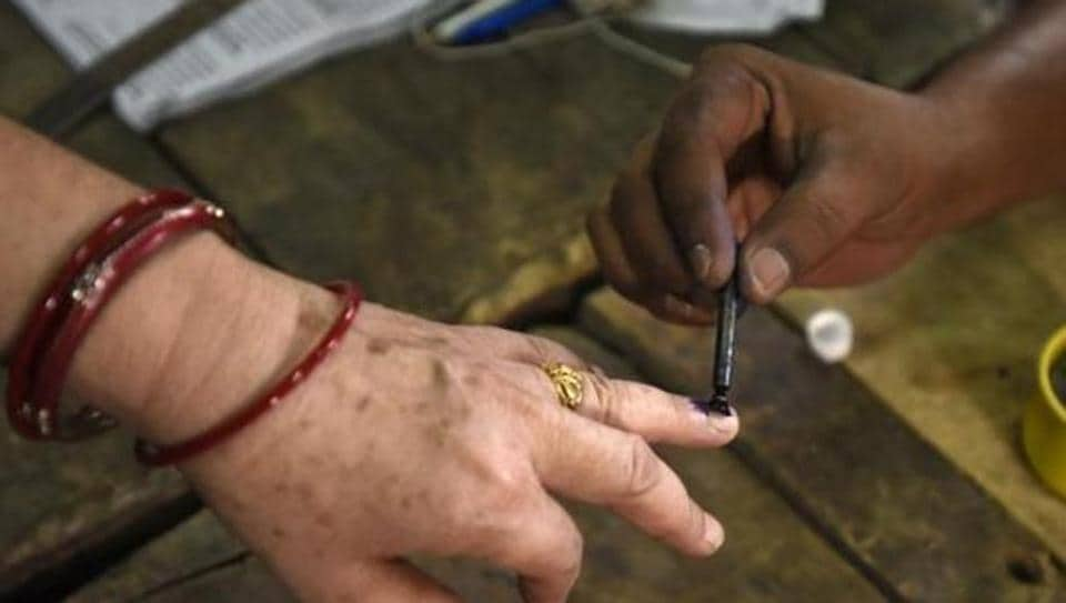 New Delhi, India-April 23, 2017: A man Ink mark a voter finger during the casting her vote for the MCD election 2017, in polling station no. 50, in East Delhi, India on Sunday, April 23, 2017.