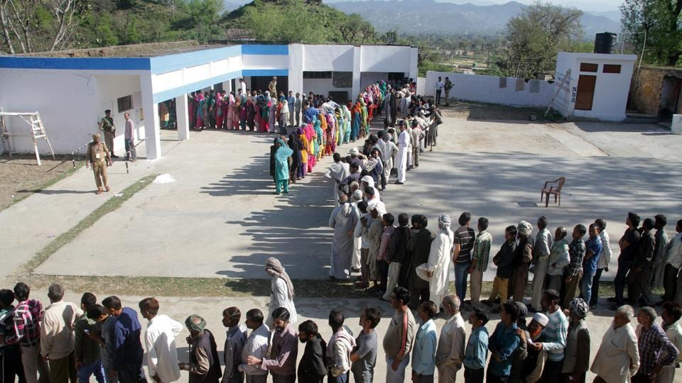 Voters stand in a queue to cast their votes at a polling station during parliamentary elections in Jammu, India, on Thursday, April 10, 2014. Millions of people are voting in the third phase of the elections Thursday, covering parts of 11 of India's 28 states. The multiphase voting across the country runs until May 12, with results for the 543-seat lower house of parliament announced May 16.