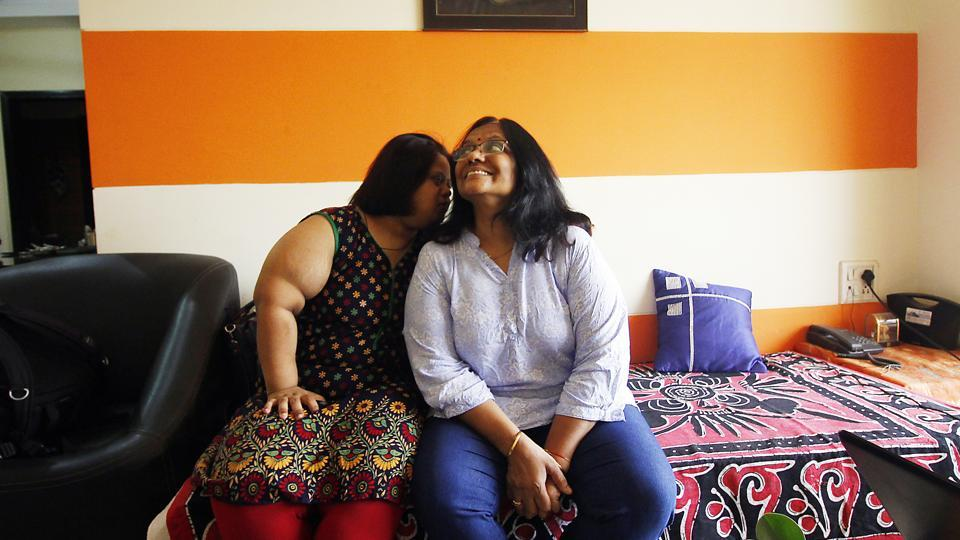 Aditi Verma (L) with her mother Reena Verma at their home in Mumbai. Born with Down syndrome, 24-year-old Aditi runs a cafe in Navi Mumbai's Bhoomi Mall. From living at home to becoming a self-reliant entrepreneur, Aditi's is a journey of inclusion and endeavour. (Hemanshi Kamani / HT Photo)