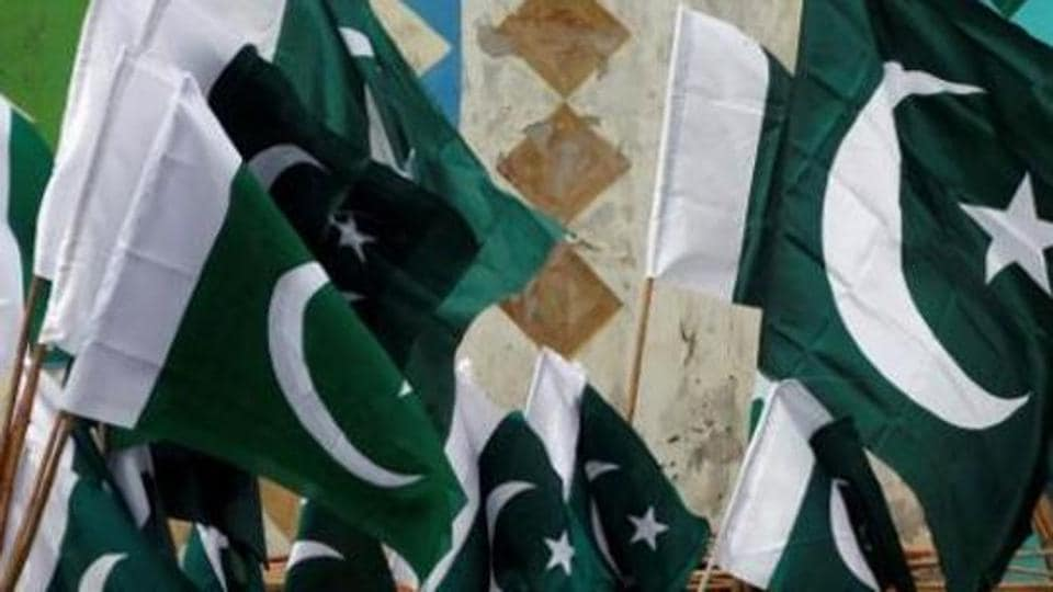 Pakistani national flags for sale along a road in Karachi.