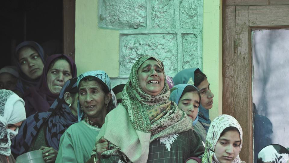 Relatives of the minor boy, who was found dead at the encounter site, seen mourning over his death, at Hajin in north Kashmir's Bandipora on March 22.