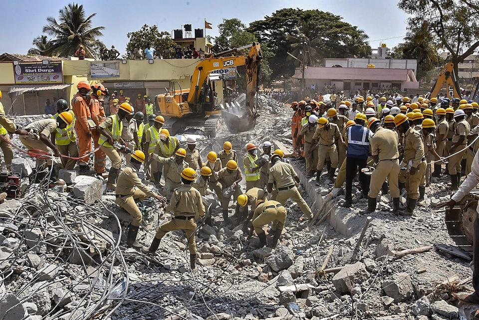 Rescue teams conduct operations after an under-construction building collapsed, at Dharwad in north Karnataka, Thursday, March 21, 2019.