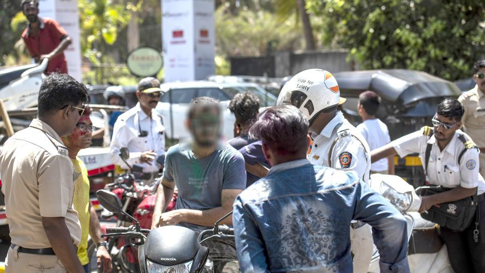 As part of its  special drive on Holi, Mumbai Police and traffic department took action against those riding two-wheelers without a helmet, those riding triple seat and drink driving.