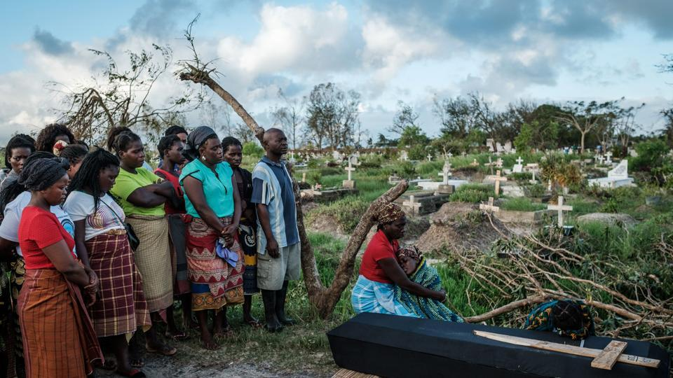 Rebecca Albino (R), a mother of three, mourns beside the coffin of her husband during his funeral, following tropical cyclone Idai which hit Beira, Mozambique. Cyclone Idai cut a swathe through Mozambique, Zimbabwe and Malawi. (Yasuyoshi Chiba / AFP)