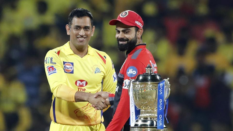 Chennai Super Kings captain Mahendra Singh Dhoni, left, shakes hands with Royal Challengers Bangalore captain Virat Kohli (AP)