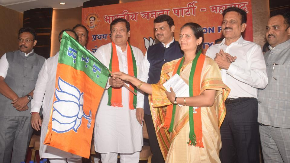 Chief minister Devendra Fadnavis welcomes Pravin Chheda from the Congress and Bharati Pawar from the NCP into the BJP, at Churchgate on Friday.