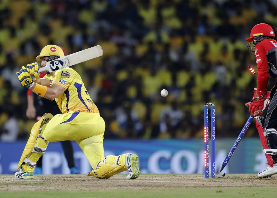 Chennai Super Kings' Shane Watson, left, is bowled out by Royal Challengers Bangalore's Yuzvendra Chahal. (AP)