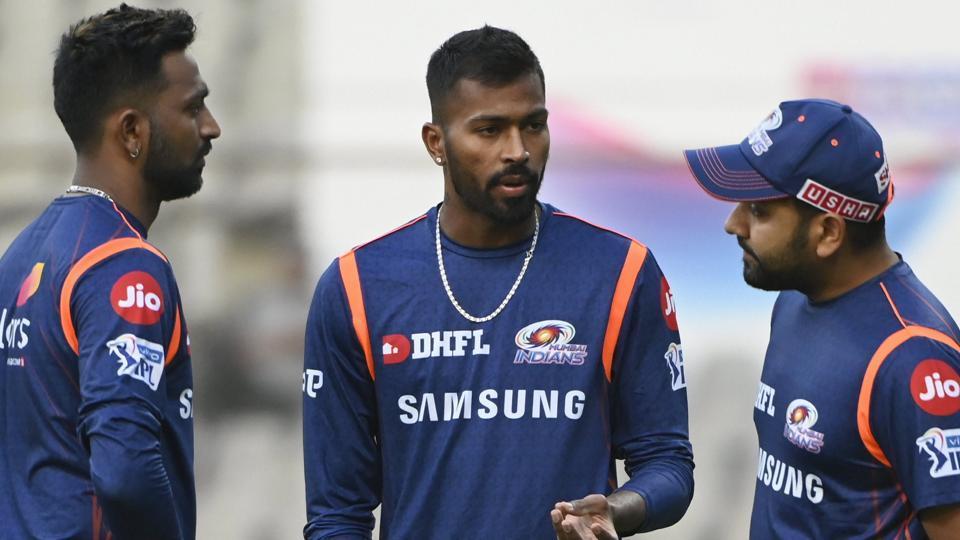 Mumbai Indian's captain Rohit Sharma with teammates Krunal and Hardik Pandya during a practice session .
