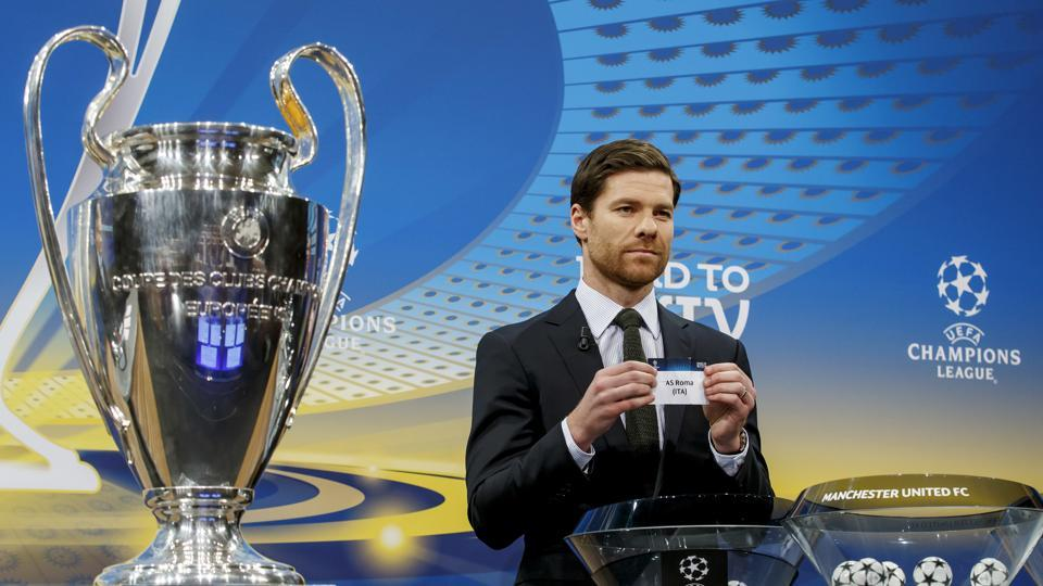 Former Spanish soccer player Xabi Alonso shows a ticket of Italian club AS Roma, during the draw of the games for the Champions League 2017/18 Round of 16, at the UEFA headquarters, in Nyon, Switzerland, Monday, Dec. 11, 2017.