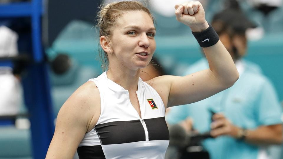 Simona Halep of Romania waves to the crowd after her match against Polona Hercog of Slovenia.