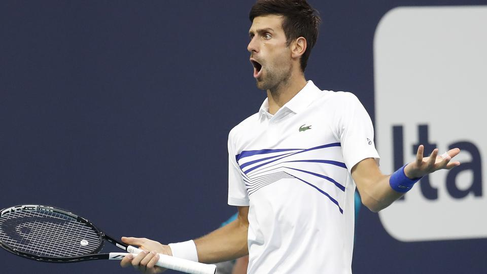 Novak Djokovic of Serbia reacts while arguing a line call against Federico Delbonis of Argentina.
