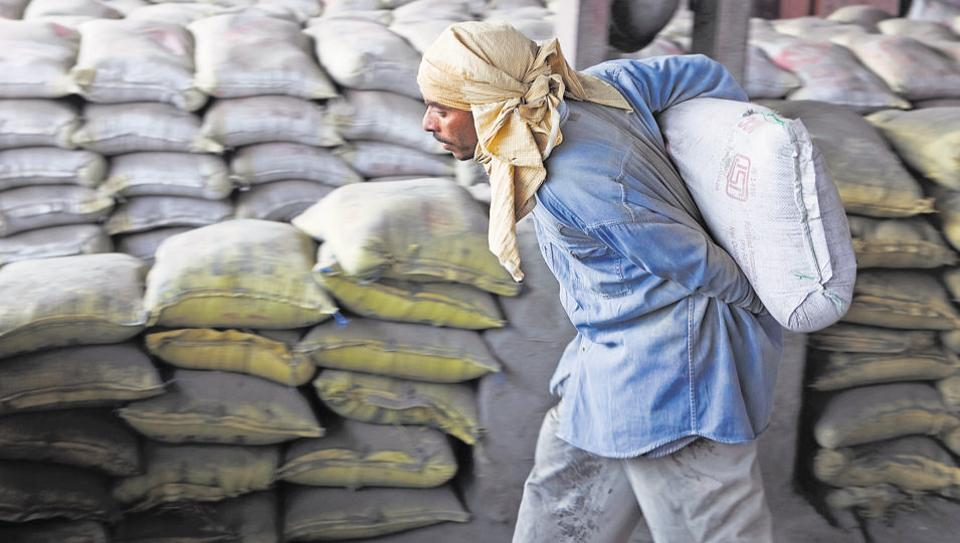 Laborers unload cement bags from freight trains at the Shakur Basti station in New Delhi, India, on Tuesday, April 5, 2011. Image for representation.