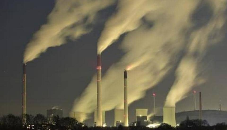 Smoke streams from the chimneys of a coal-fired power station.