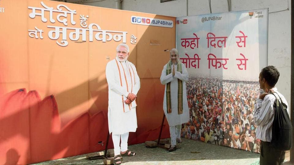Cut-outs of PM Narendra Modi and party national president Amit Shah outside the BJP office in Patna.
