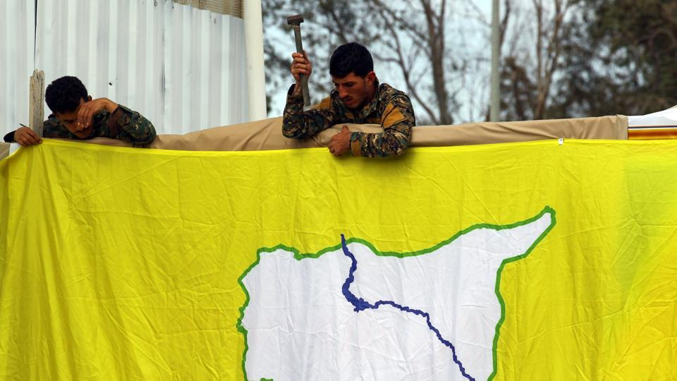 "Syrian Democratic Forces put an SDF flag in al-Omar oil field in Deir Al Zor. France and Britain, which also back the SDF, welcomed the developments, though US officials acknowledged work remained. In a separate statement Saturday, President Donald Trump said the region had been ""liberated,"" but added the United States will remain vigilant. (Aboud Hamam / REUTERS)"