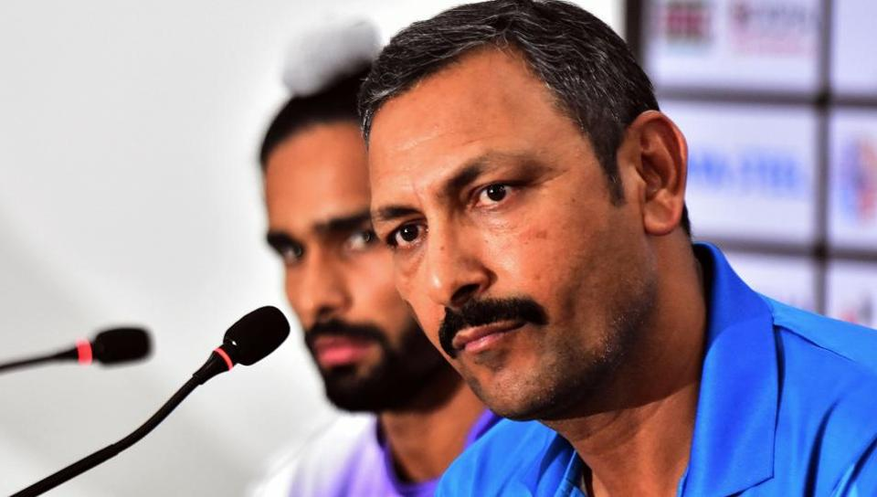 A file photo of Harendra Singh (R) takes part in a press conference at Kalinga Stadium.