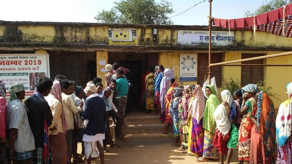 People queue outside a polling station to cast their vote during the first phase of the Chhatisgarh assembly elections at Sukma district on Monday, November 12, 2018. The first phase of elections for 18 seats are spread across eight Maoist-affected districts with nearly one lakh security personnel deployed amid threats from Maoist who have called for boycott of the elections.