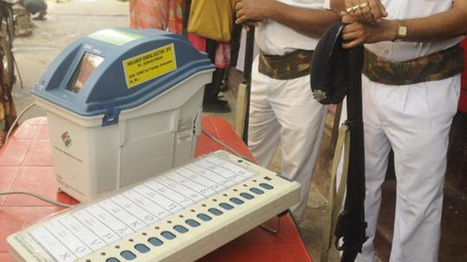A view of an EVM (Electronic Voting Machine) and VVPAT (Voter Verifiable Paper Audit Trail), near Shyambazar AV School, in Kolkata, West Bengal, India, on Tuesday, March 19, 2019. Directed by District Election Officer, as part of an awareness programme, officials show EVMs and VVPATs to people.