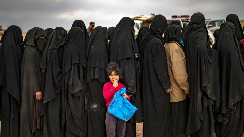 Women and children queue at a screening point as civilians stream out of Baghouz. In 2014, IS grabbed Iraq's Mosul, erased the border with Syria and called on supporters worldwide to join a jihadist utopia, complete with currency, flag and passports. Its excesses drew an array of forces against it, driving it from Mosul and the Syrian city Raqqa during a year of heavy defeats in 2017 and down the Euphrates to Baghouz. (Delil Souleiman / AFP)