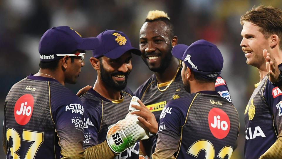 Kolkata Knight Riders' cricketer Lockie Ferguson (2ndR) and teammates celebrate after taking the wicket of Kings XI Punjab's cricketer Lokesh Rahul.