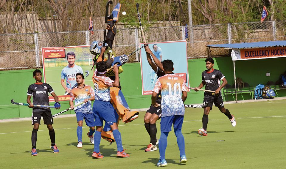 Income Tax Pune (black) in action against Excellency Academy during the first edition of Moti John hockey tournament at Dhyanchand hockey stadium on Wednesday.