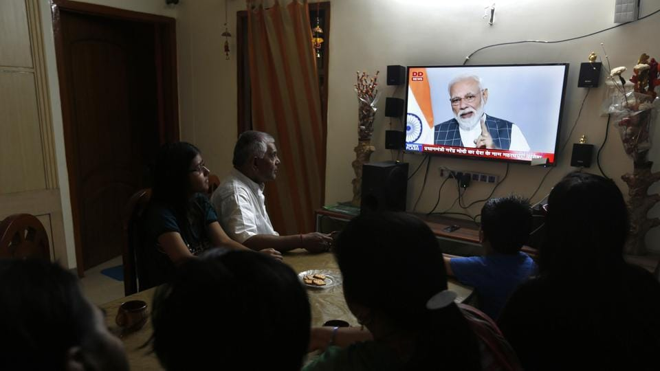 A family in Prayagraj, Uttar Pradesh, watches Prime Minister Narendra Modi addressing the nation on Wednesday when he announced the successful test of an anti-missile weapon.