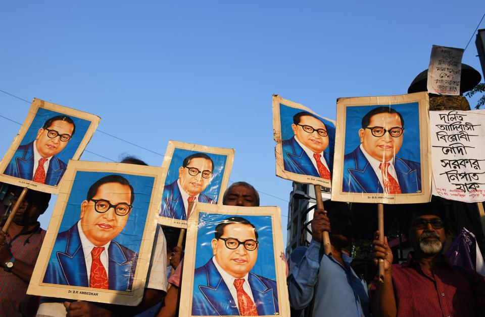 Activists holding portraits of BR Ambedkar during a protest in Kolkata on April 4, 2018.