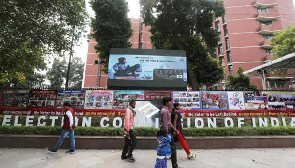 People walk past the Election Commission of India office building in New Delhi, India March 11, 2019.