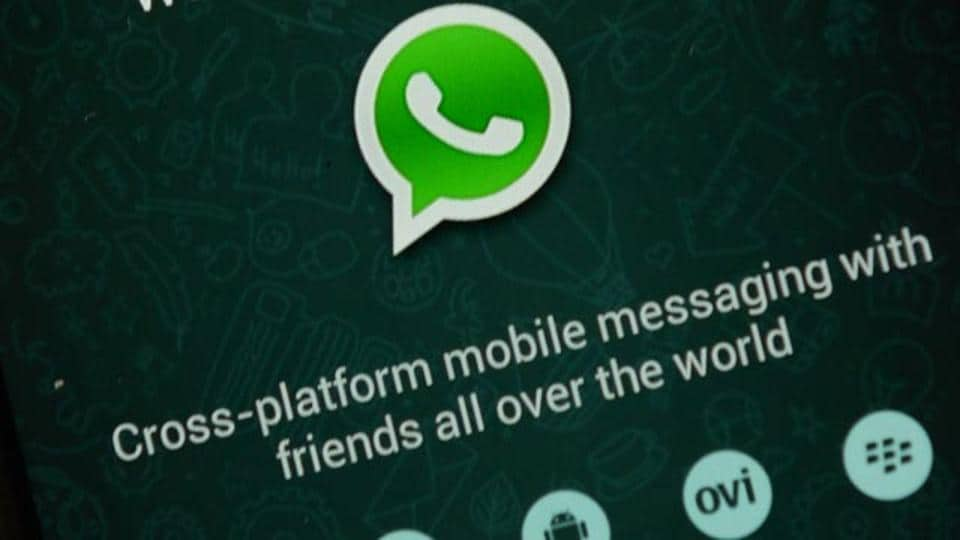 WhatsApp testing dark mode, fingerprint authentication for Android.