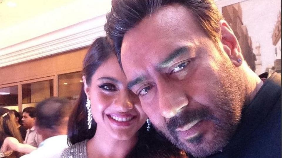 What a cute couple! Actors Kajol  and Ajay Devgn also took to the Twitter Mirror and were caught in a candid-perfect moment. (HT Photo)