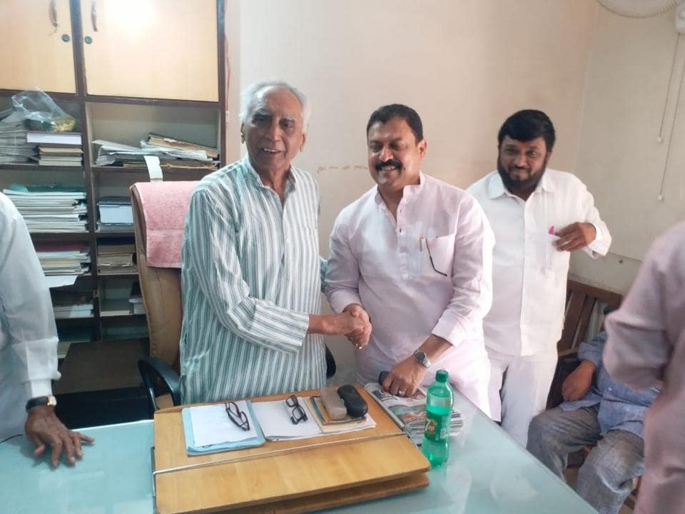 Arvind Shinde meets senior activist Baba Adhav (left) at the latter's office in the city on Thursday.