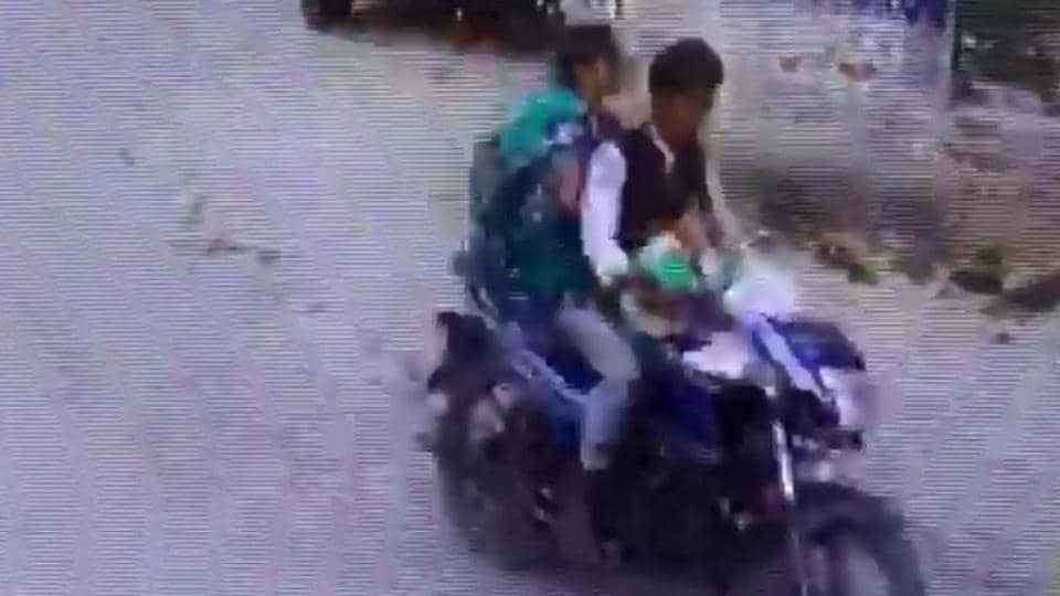 A CCTV grab of the couple allegedly making away with the baby. Police said they are trying to trace the couple.