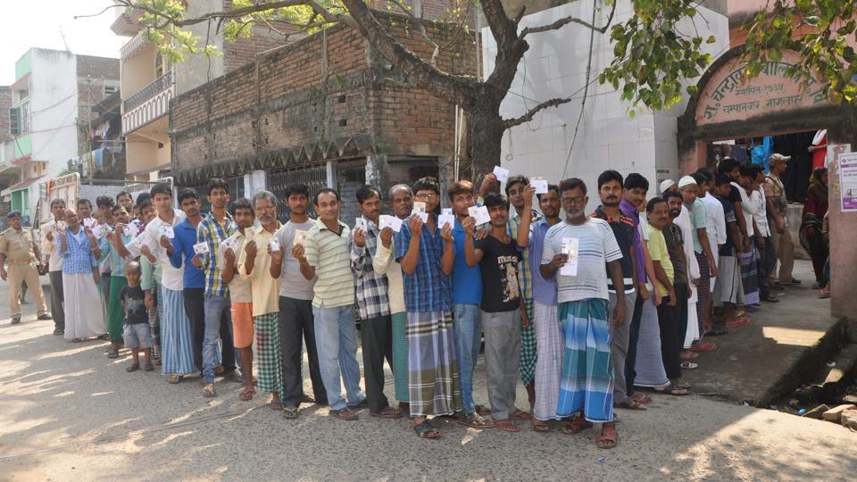 Voters wait in a long queue to cast votes during the first phase of Bihar Assembly polls, outside a polling booth at Champanagar Tanti Bazar of Nathnagar, in Bihar, India on Monday, October 12, 2015.