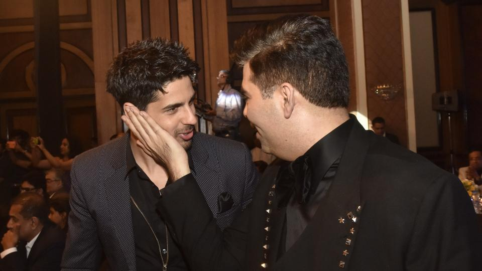 Cute alert! Actor Sidharth Malhotra's caught in a candid frame with filmmaker Karan Johar. (Pratik Chorge/HT Photo)