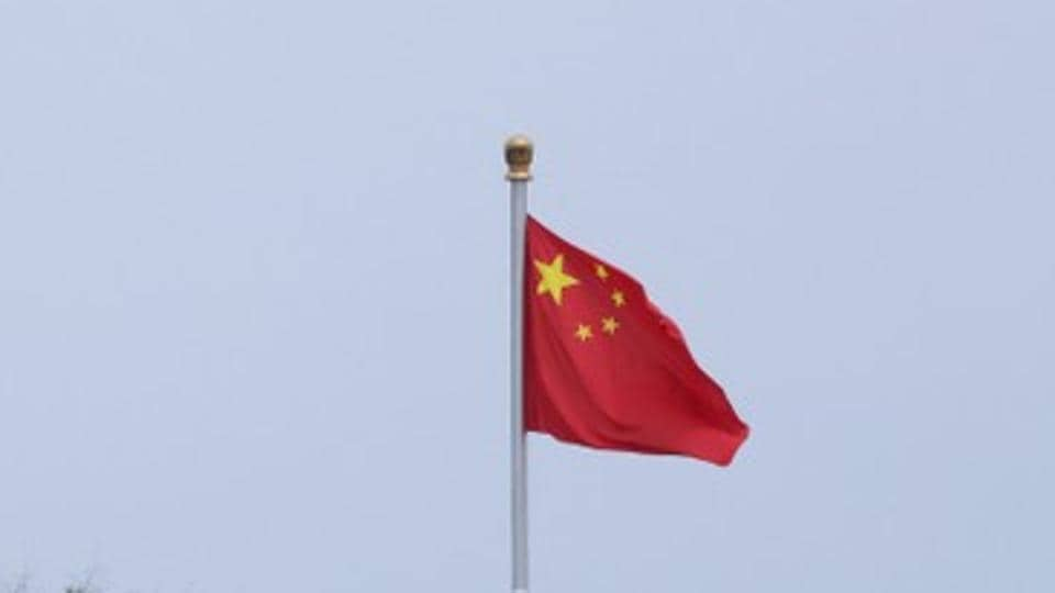 A Chinese flag flutters at Tiananmen Square in central Beijing.