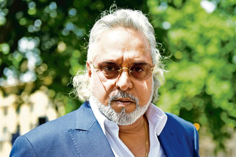 Fugitive liquor baron Vijay Mallya leaves after an extradition hearing at Westminster Magistrates Court, in central London.