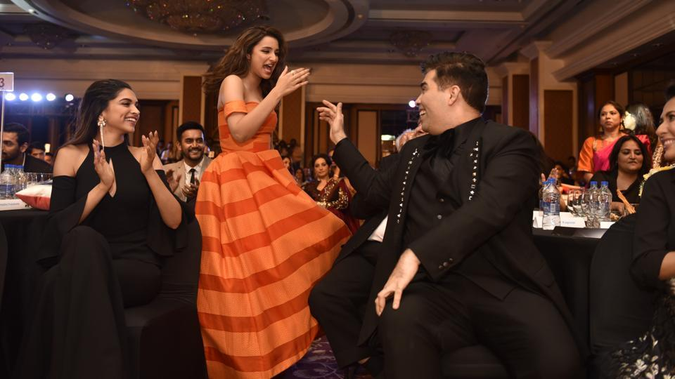 Parineeti Chopra ensured that the evening was fun. Seen here with Deepika Padukone and Karan Johar.  (Anshuman Poyrekar/HT Photo)