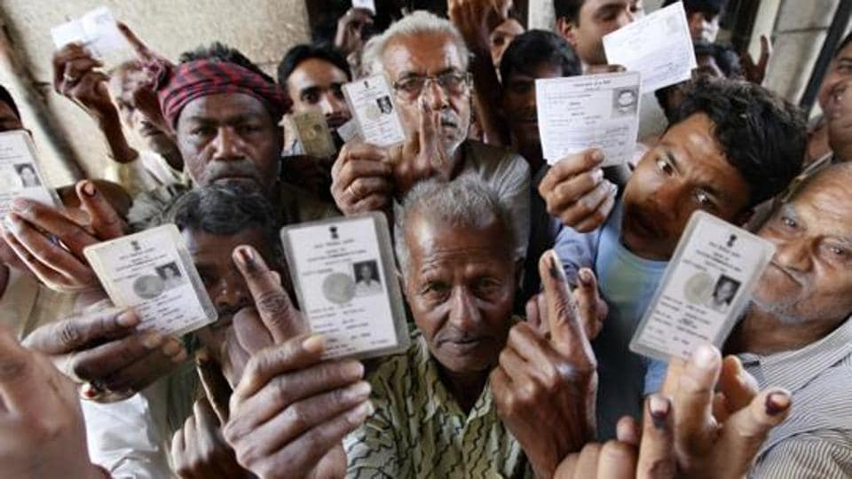 Homeless voters show their inked fingers after casting their votes for Lok Sabha elections, at Chandni Chowk, in New Delhi, India, on Thursday, April 10, 2014.