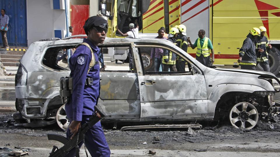 At least 15 people died when a bomb exploded on a busy street and ripped into a nearby restaurant in Somalia's capital on Thursday.