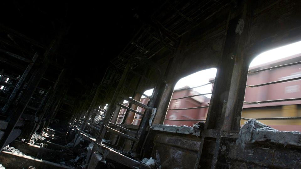 A view of a burnt carriage of Samjhauta Express train in Deewana, near Panipat town, February 19, 2007. REUTERS/Desmond Boylan/File Photo