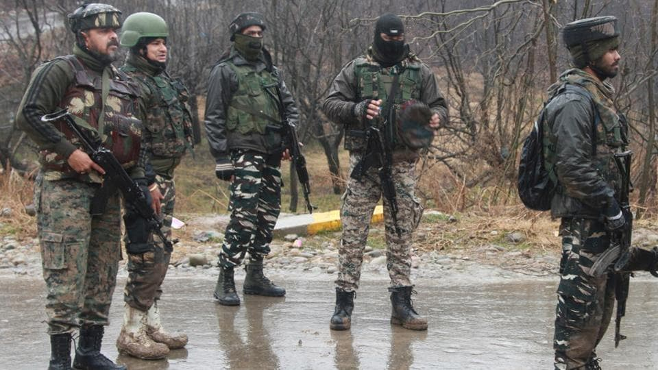 Army jawans stand guard near encounter site at Shopian Heff-Shirmal in South Kashmir.