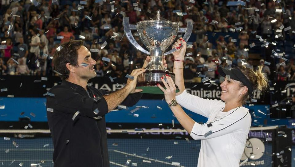 Roger Federer and his mixed doubles partner Belinda Bencic of Switzerland with the Hopman Cup after defeating runners-up Alexander Zverev and Angelique Kerber of Germany in the final on day eight of the Hopman Cup tennis tournament in Perth on January 5, 2019.