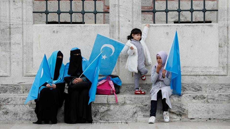 Uighur women hold East Turkestan flags at the courtyard of Fatih Mosque. Turkey is the only Muslim country that has regularly expressed concern about the situation in Xinjiang, due to its close cultural links with the Uighurs who speak a Turkic language. (Murad Sezer / REUTERS)