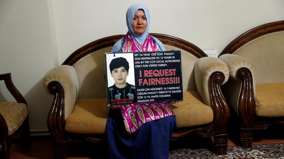 "The Xinjiang government did not respond to a request for comment. The family regularly attends protests around Turkey in the hopes of having their voices heard. ""When my son was arrested, he was only a 16-year-old kid. His younger siblings ask us constantly when they'll be united with their older brother,"" Pakzat's mother Gulgine Mahmut said. ""I don't believe he was involved in a crime, I think he was falsely accused."" (Murad Sezer / REUTERS)"