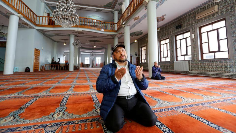 Qurbanjan Nourmuhammed prays at a mosque in Istanbul. Nourmuhammed has not heard from his son Pakzat since he went back to Xinjiang in 2016 to visit his grandparents. A friend of Pakzat's told Nourmuhammed that Pakzat was detained upon arrival. He believes the government accuses him of having links with extreme Islamists. (Murad Sezer / REUTERS)