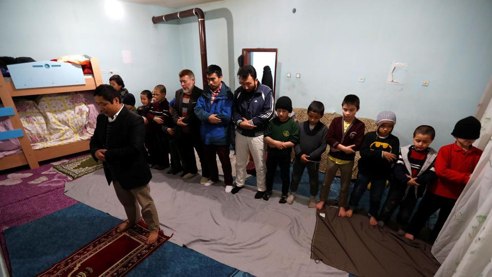Uighur men and boys perform their evening prayers led by Ruz Mohammed, known as Hafiz Bilal, in a madrasa,  in Kayseri. Perceptions of Uighurs suffered after some went to fight with jihadists against President Bashar al-Assad's forces, because of the Syrian government's close ties with Beijing, Tumturk said, adding China has ramped up pressure since then. (Murad Sezer / REUTERS)