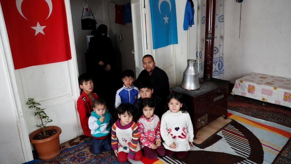 Abdulaziz Abdulvahid, a 39-year-old Uighur man who has health problems and survives on Red Crescent aid, with his wife and seven children at their home in Kayseri. Some 15 Uighurs who spoke to Reuters said they expect Turkey to pay more attention to their plight and give them the permits to allow them to work and benefit from the healthcare system. (Murad Sezer / REUTERS)